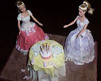 Doll cake with Two dolls and table set up for birthday party