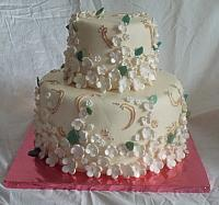Ivory Anniversary Cake with Asian Floral Brocade decorations