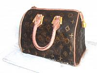 Jennifer Hernandez ordered this Louis Vuitton Fashion Purse Cake for her birthday.  She wanted the cake to be a reproduction of a purse she owned.  It is red velvet cake.  All the decorations on the purse are edible and made out of gumpaste.