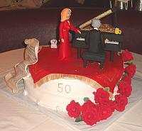 50th Anniversary Cake with Musical Couple with all Edible Decorations including Grand Piano, Oriental Rug, Bichon Dogs, Roses, Sheet Music