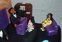 Church Scene with Female Congregation Gumpaste Figurine in Yellow Dress Close Up