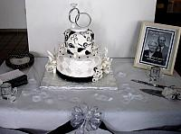 Anniversary Paisley Streamers Black White Fondant Cake on table