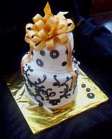 Whimsical Black and White Fondant Cake with Gold Bow and Silver Dragree Accents main view