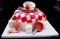 Pizza and Italian Food Themed Fondant Cake with Edible Chef Hats, Copper Pots, Grapes, Spagetti front view