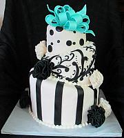 Whimsical Topsy Turvy Black and White Fondant Cake with Teal Bow and Fantasy Flowers