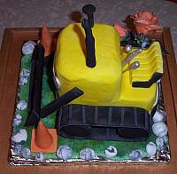Bulldozer cake covered in fondant with gumpaste attachments