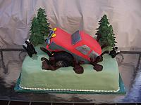Groom's Off Road Truck Cake in chocolate mud with edible trees and hand modeled skunks
