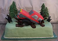 Groom's Cake with Off Road Truck with edible skunks, truck, trees, chocolate mud