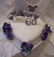 Eileen Perry's Heart shaped birthday cake with sugarpaste purple roses and sugarpaste victorian-themed decorated hearts