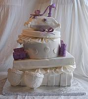 Stacked presents with purple and white edible gumpaste and fondant decorations for Metta's bridal shower