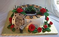 Side view of Greg's birthday cake. the metallic plate is edible. The vines and leaves are edible.