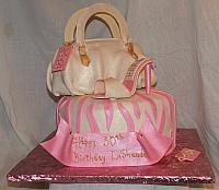 Designer Purse cake with designer shoe and zebra striped cake