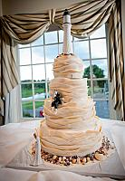 Nautical Theme Ivory Wedding Cake with Fondant Waves,  Edible Lighthouse, Rocks, Gold Shells