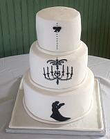White fondant covered Wedding Cake with dancing couple silhouette cut out of gumpaste under royal icing decorated chandelier View 2