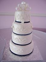 Simple White Fondant covered Wedding cake