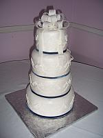 Simple white wedding cake with edible gumpaste bow on top