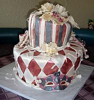 Mardi Gras Themed Wedding Cake with Masks and Peony Flowers