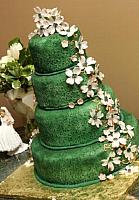 Rich Green Wedding Cake with edible gumpaste dogwood floral spray on each side of cake
