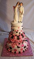 Bride Kissing Groom On Whimsical Cake