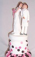 Bride Kissing Groom Figurines on Whimsical Cake