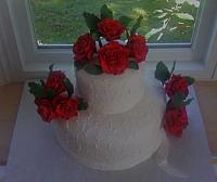 One Dozen Red Roses On White fondant-covered Cake