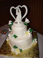 White Wedding Cake With pearl necklace fondant border and gumpaste(aka sugarpaste) Frangipani Flowers - Click on it to enlargen